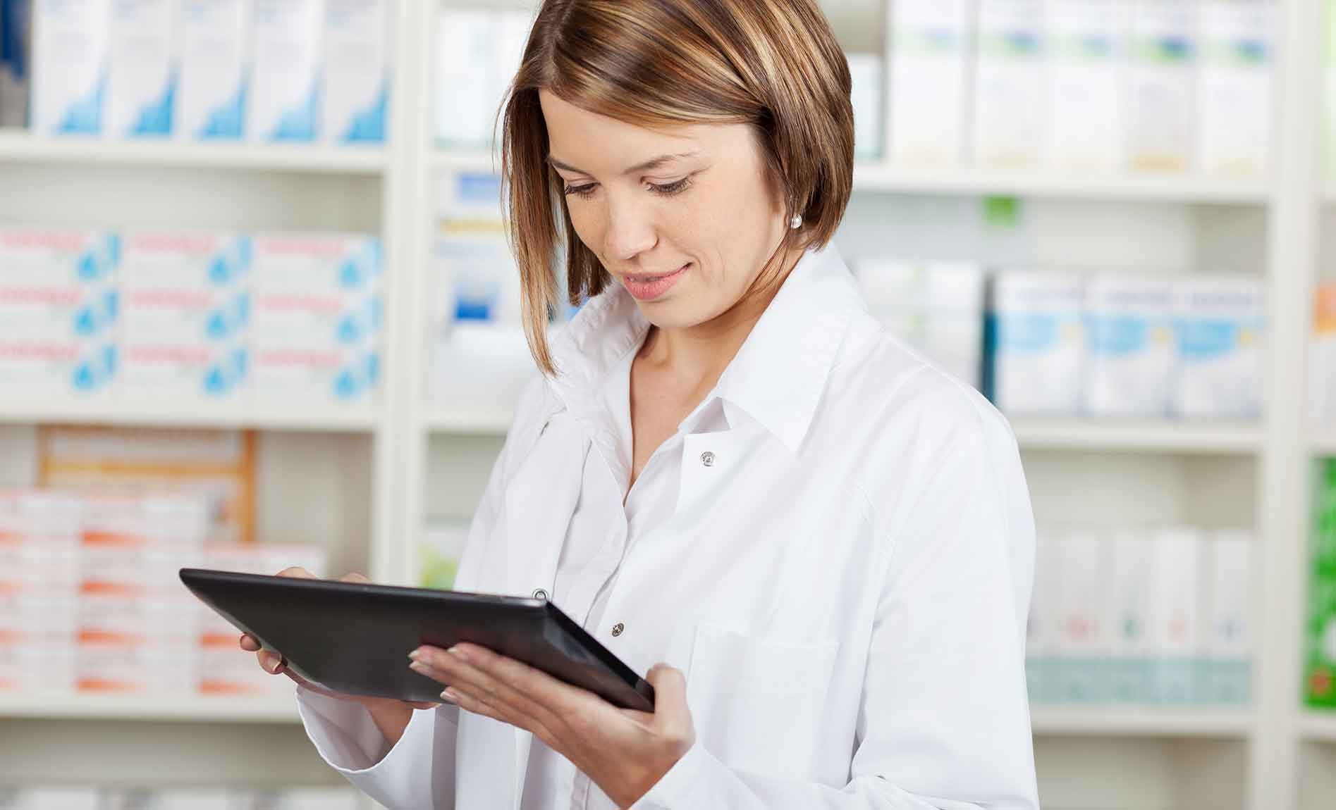 veterinarian with tablet